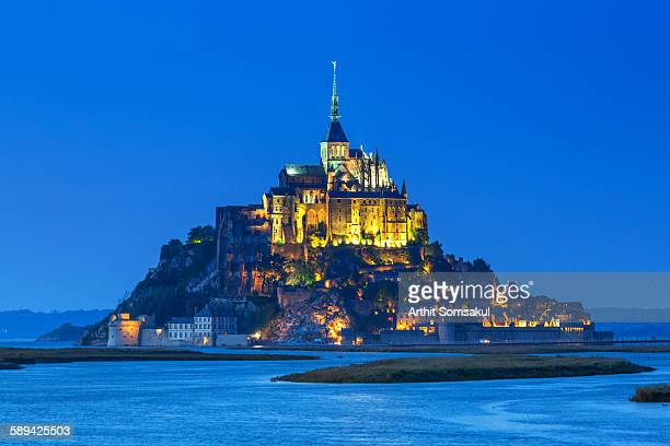 Mont Saint-Michel at sunset with water in surround