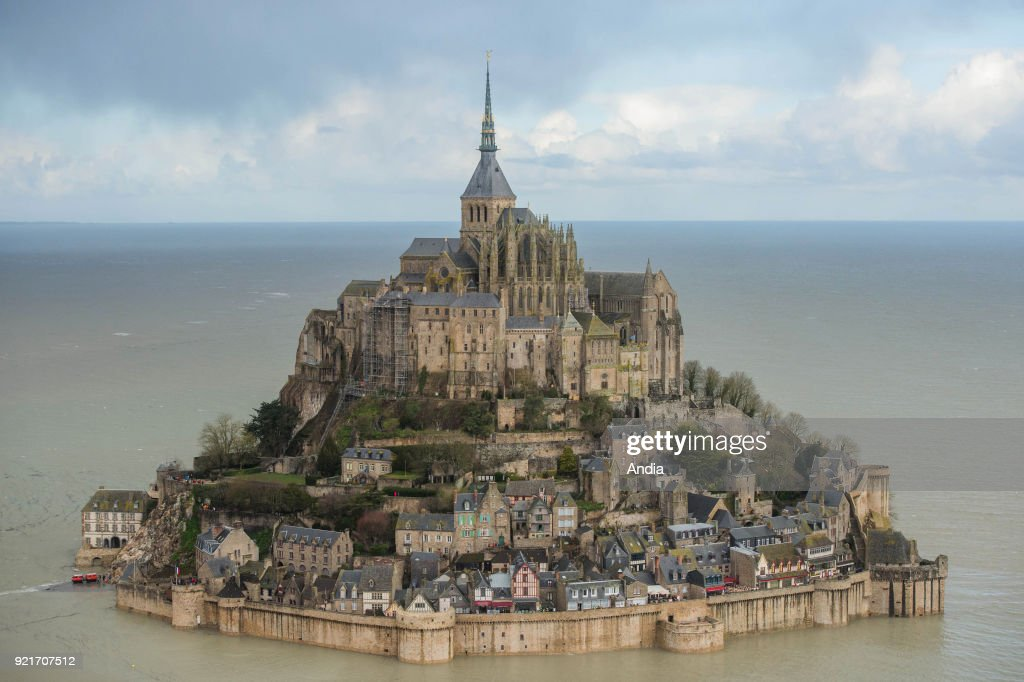 Mont Saint-Michel (Saint Michael's Mount), Normandy, north-western France: aerial view of Le Mont Saint-Michel and its abbey during a spring tide on , 117 tidal coefficient. Le Mont Saint-Michel surrounded by water after the works to restore the maritime character of the mount.