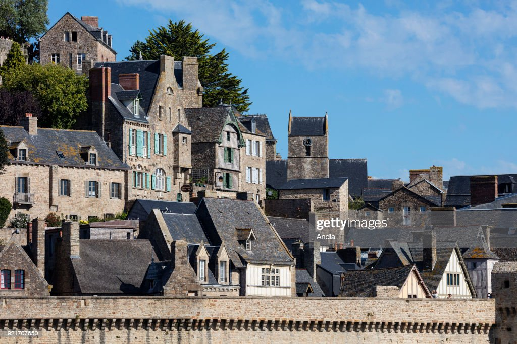 Mont Saint-Michel (Saint Michael's Mount), Normandy, north-western France: houses of the village and ramparts in the foreground.