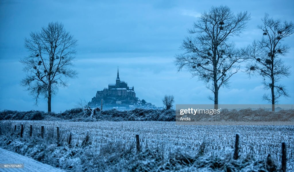 Mont Saint-Michel (Saint Michael's Mount), Normandy, north-western France: Le Mont Saint-Michel and its abbey in the morning mist and snow.