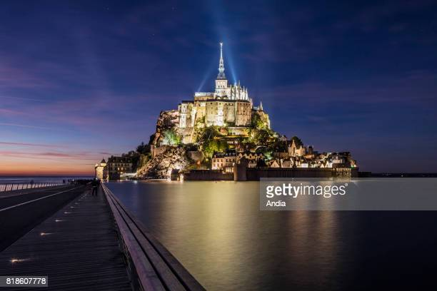 Mont SaintMichel Normandy northwestern France the mount at high tide new aspect after the works to restore the maritime character of Mont SaintMichel...