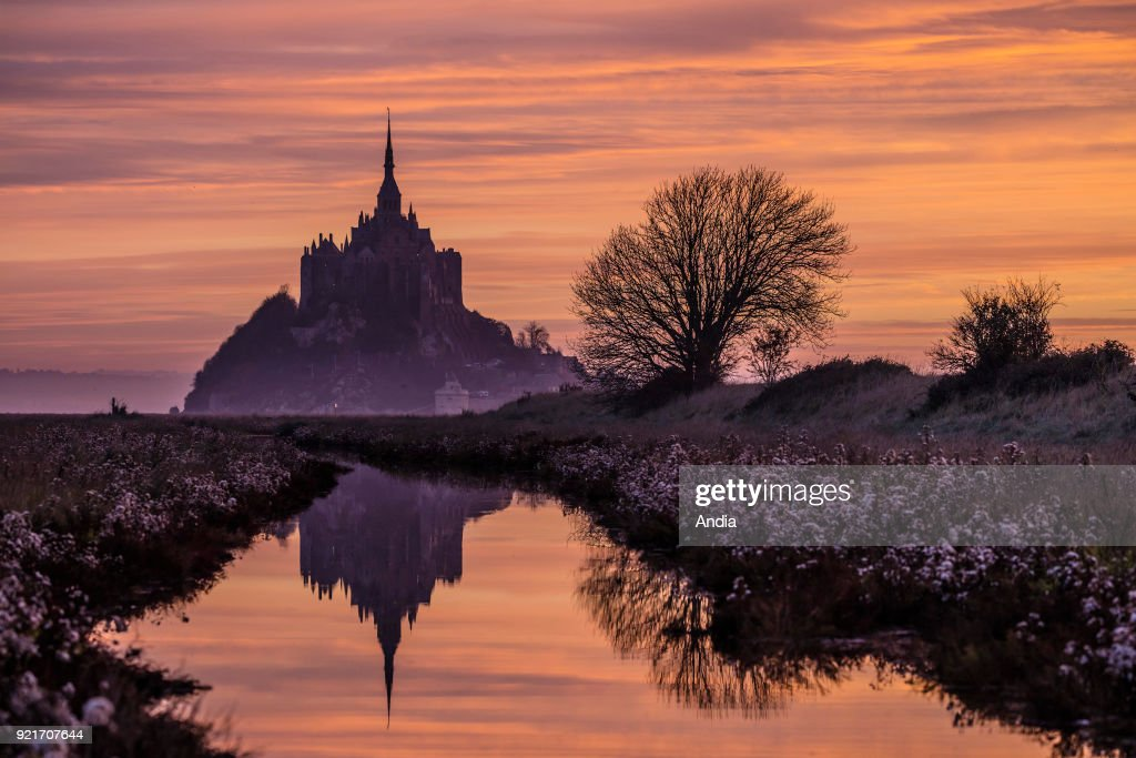 Mont Saint-Michel (Saint Michael's Mount), Normandy, north-western France: the mount at sunset.