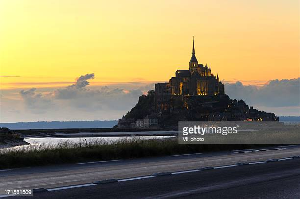 mont saint-michel - abby road stock photos and pictures