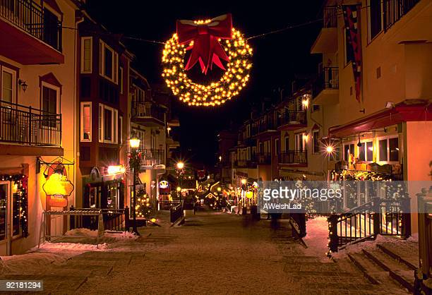 mont tremblant ski village in the evening at christmas - mont tremblant stock pictures, royalty-free photos & images