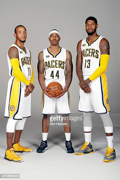 Monta Ellis Jeff Teague and Paul George of the Indiana Pacers pose for a portrait during media day at Bankers Life Fieldhouse on September 26 2016 in...