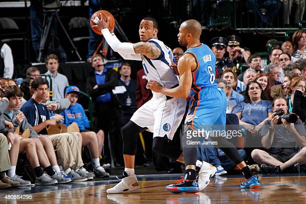 Monta Ellis of the Dallas Mavericks controls the ball against Derek Fisher of the Oklahoma City Thunder on March 25 2014 at the American Airlines...