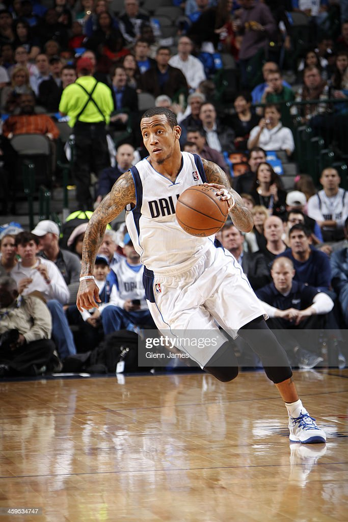 Monta Ellis #11 of the Dallas Mavericks dribbles the ball against the Memphis Grizzlies on December 18, 2013 at the American Airlines Center in Dallas, Texas.