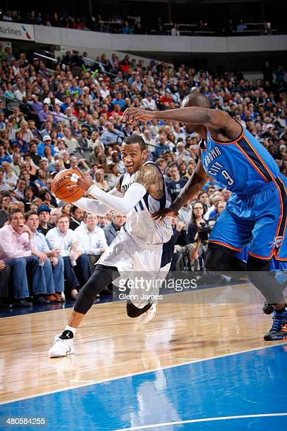 Monta Ellis of the Dallas Mavericks drives against Serge Ibaka of the Oklahoma City Thunder on March 25 2014 at the American Airlines Center in...