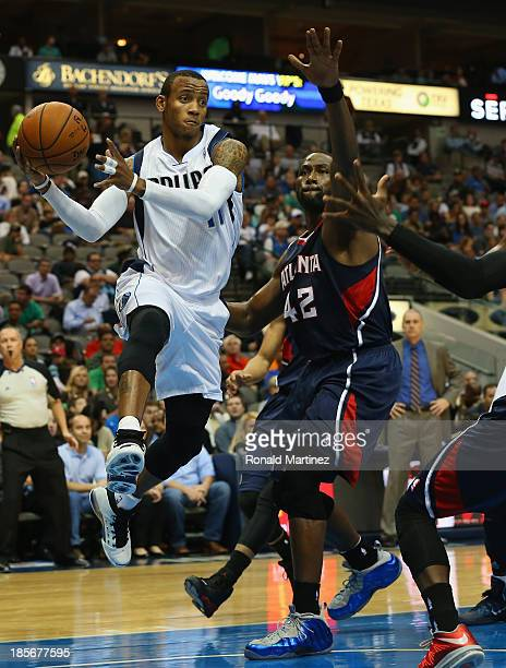 Monta Ellis of the Dallas Mavericks pass the ball against Elton Brand of the Atlanta Hawks at American Airlines Center on October 23 2013 in Dallas...