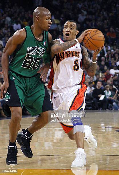 Monta Ellis of the Golden State Warriors drives against Ray Allen of the Boston Celtics during an NBA game at Oracle Arena on December 28 2009 in...