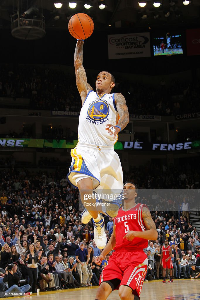 Monta Ellis #8 of the Golden State Warriors flies through the air for a dunk against Courtney Lee #5 of the Houston Rockets on December 20, 2010 at Oracle Arena in Oakland, California.