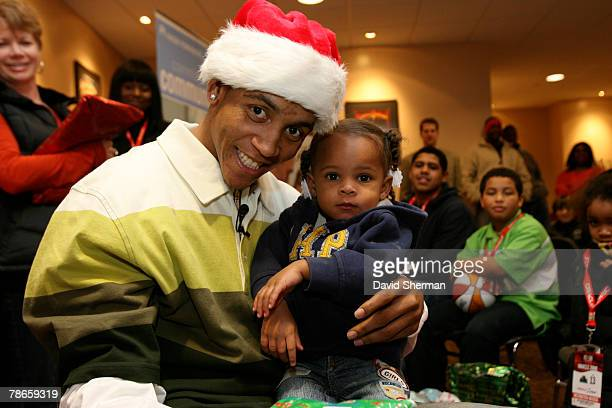 Monta Ellis of the Golden State Warriors gives holiday gifts to children from the Oakland Police Activities League on December 26 2007 at ORACLE...