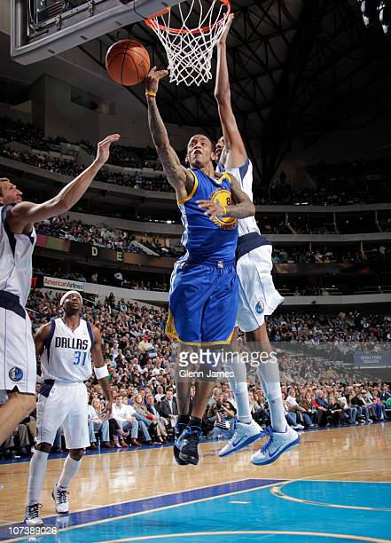Monta Ellis of the Golden State Warriors goes in for the layup against Alexis Ajinca of the Dallas Mavericks during a game on December 7 2010 at the...