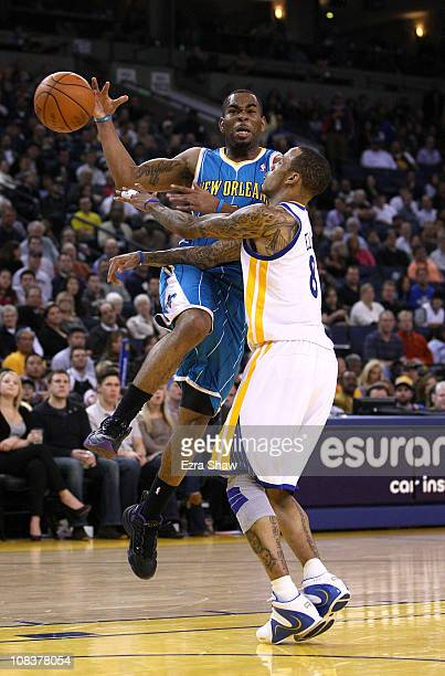 Monta Ellis of the Golden State Warriors knocks the ball away from Marcus Thornton of the New Orleans Hornets at Oracle Arena on January 26 2011 in...