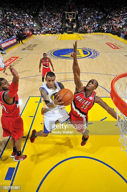 Monta Ellis of the Golden State Warriors scores on the layup against the Portland Trail Blazers on December 25 2010 at Oracle Arena in Oakland...