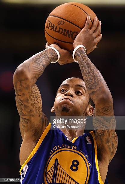 Monta Ellis of the Golden State Warriors shoots a free throw shot against the Phoenix Suns during the preseason NBA game at US Airways Center on...