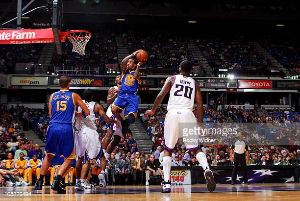 Monta Ellis of the Golden State Warriors takes the ball to the basket against the Sacramento Kings during a preseason game on October 12 2010 at ARCO...