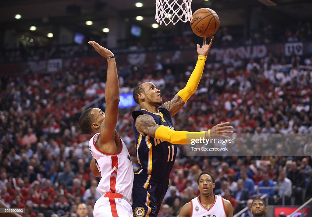 Monta Ellis #11 of the Indiana Pacers goes past Norman Powell #24 of the Toronto Raptors to score a basket in Game One of the Eastern Conference Quarterfinals during the 2016 NBA Playoffs on April 16, 2016 at the Air Canada Centre in Toronto, Ontario, Canada.