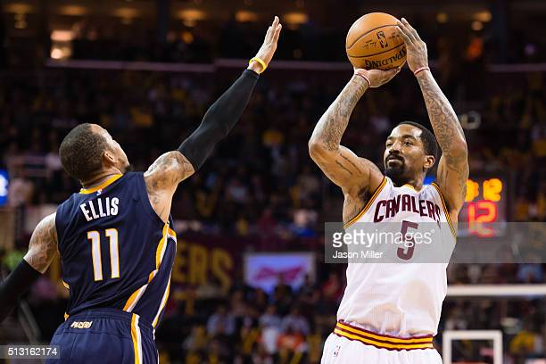 Monta Ellis of the Indiana Pacers tries to block JR Smith of the Cleveland Cavaliers during the second half at Quicken Loans Arena on February 29...