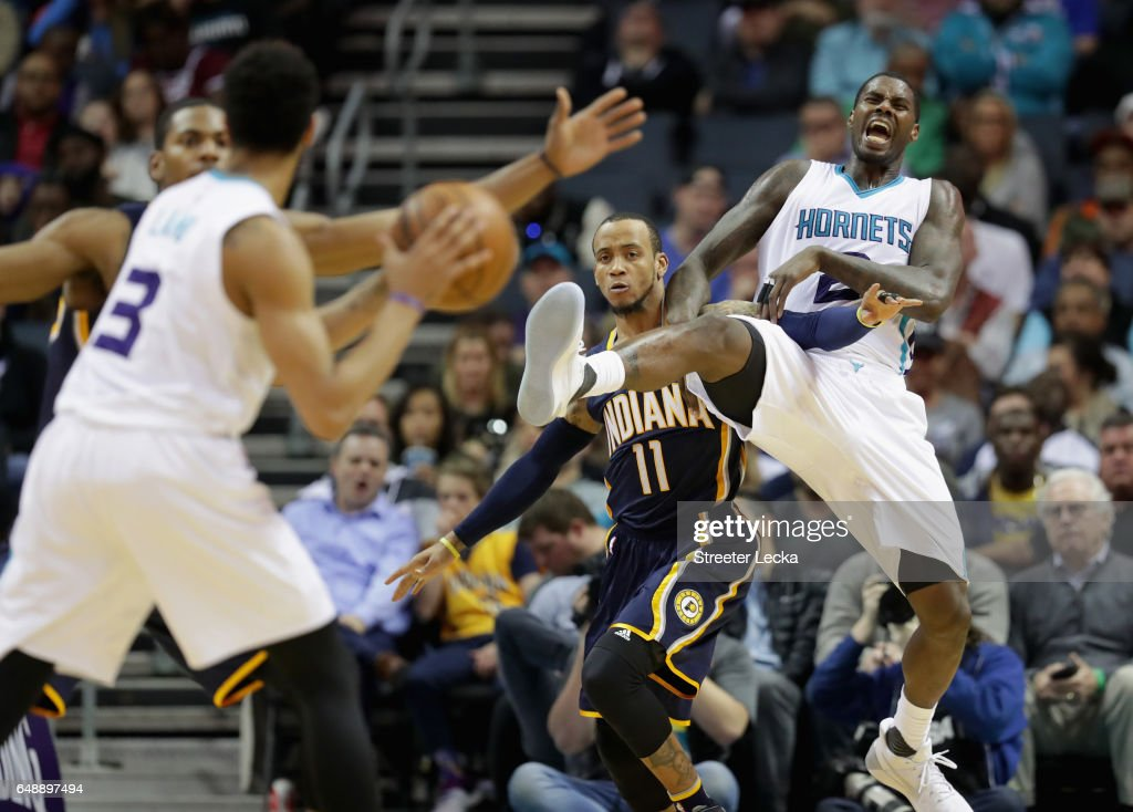 Monta Ellis #11 of the Indiana Pacers tries to stop Marvin Williams #2 of the Charlotte Hornets from getting a pass during their game at Spectrum Center on March 6, 2017 in Charlotte, North Carolina.