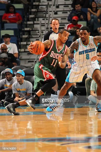 Monta Ellis of the Milwaukee Bucks drives against Roger Mason Jr #8 of the New Orleans Hornets during the game between the New Orleans Hornets and...