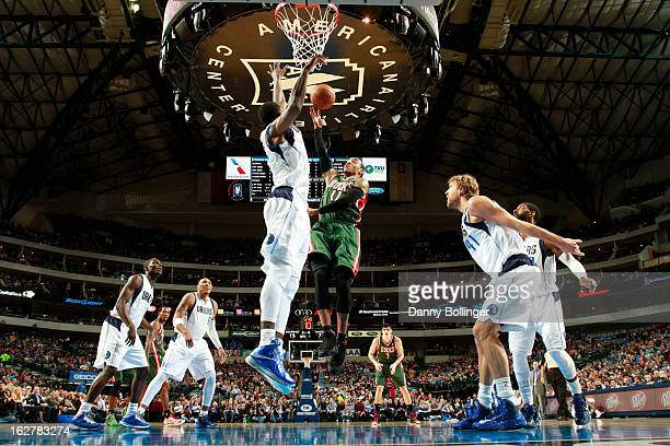 Monta Ellis of the Milwaukee Bucks goes in for the layup against Bernard James of the Dallas Mavericks on February 26 2013 at the American Airlines...
