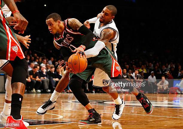 Monta Ellis of the Milwaukee Bucks in action against CJ Watson of the Brooklyn Nets at Barclays Center on February 19 2013 in the Brooklyn borough of...