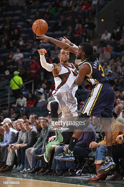 Monta Ellis of the Milwaukee Bucks passes against DeMarre Carroll of the Utah Jazz on March 4 2013 at the BMO Harris Bradley Center in Milwaukee...