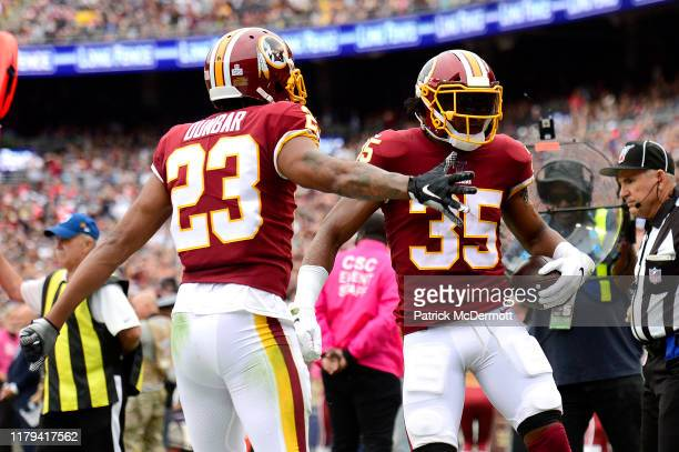 Montae Nicholson is congratulated by his teammate Quinton Dunbar of the Washington Redskins after his interception against the New England Patriots...
