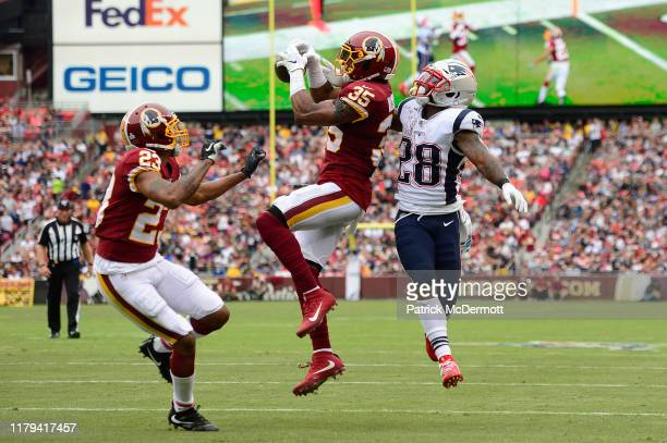 Montae Nicholson of the Washington Redskins intercepts a ball intended for James White of the New England Patriots during the second quarter in the...