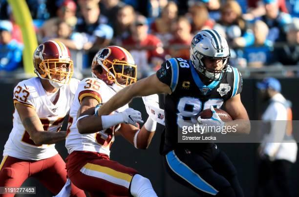 Montae Nicholson of the Washington Redskins tries to stop Greg Olsen of the Carolina Panthers during their game at Bank of America Stadium on...