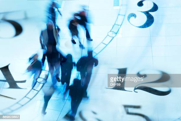 montage of blurred pedestrians walking and several clock faces - time stock pictures, royalty-free photos & images
