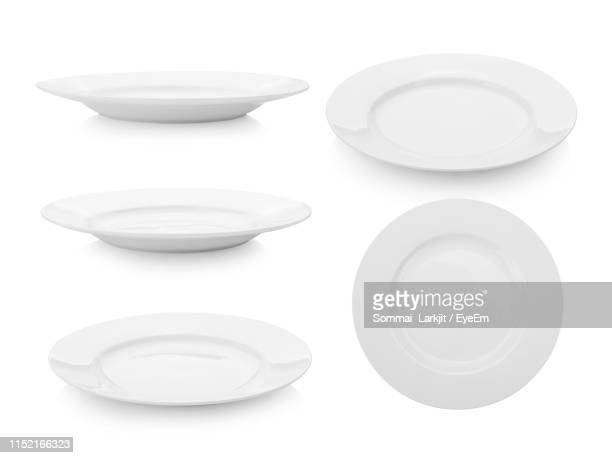 montage of ceramic plates against white background - plate stock pictures, royalty-free photos & images