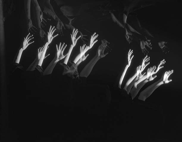 Montage of outstretched arms.