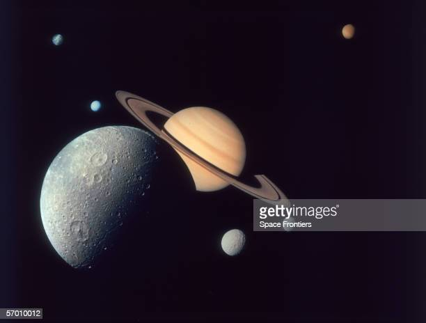 Montage of Saturn and its moons Dione , Tethys and Mimas , Enceladus and Rhea , and Titan , as depicted by the Voyager 1 spacecraft, November 1980.