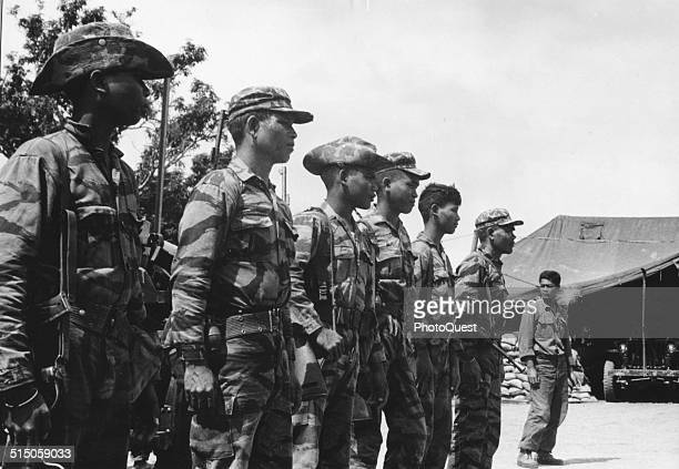 Montagnards line up for equipment check before patrolling area Ban Don Vietnam 1964 Ban Don is located near communist infiltration route from North...