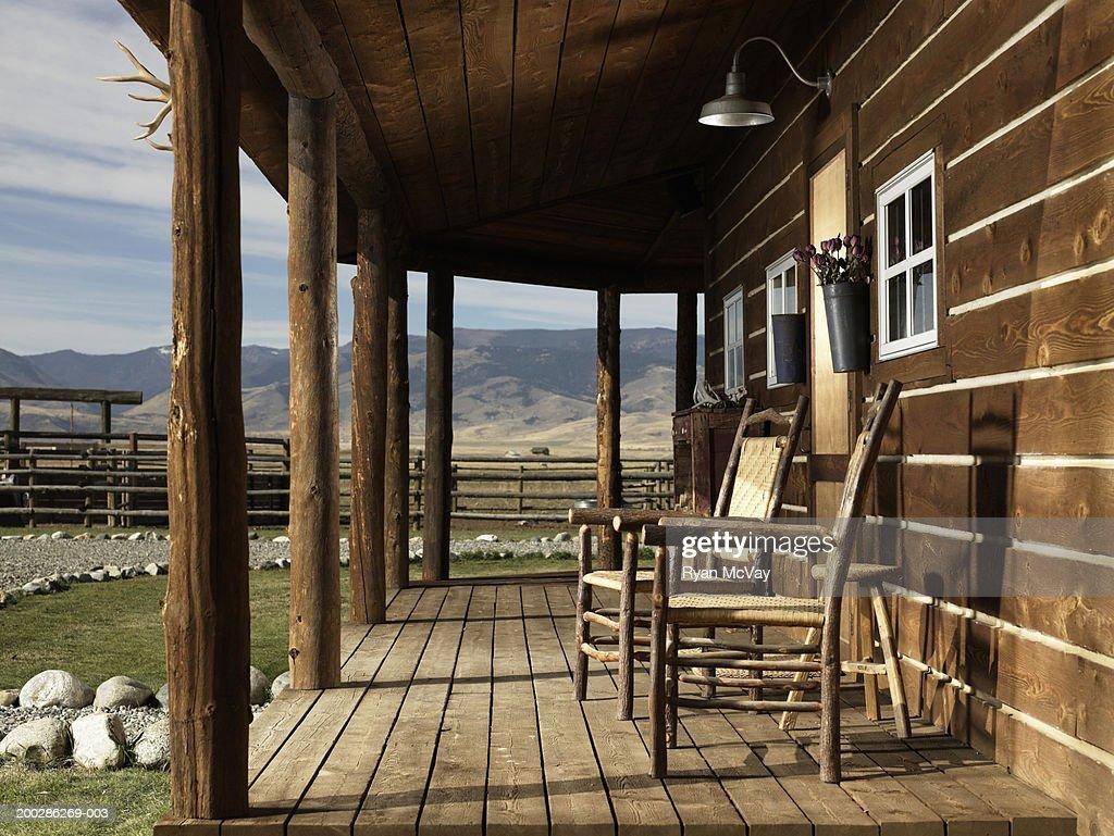 USA, Montana, Bozeman, chairs on porch of cabin : Stock Photo