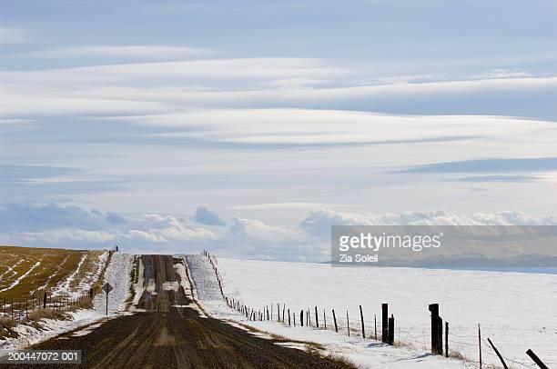 usa, montana, bozeman, empty road, winter - bozeman stock pictures, royalty-free photos & images