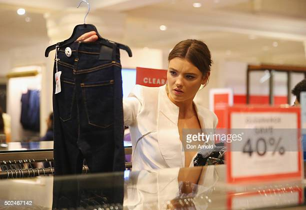 Montana Cox inspects mechandise inside the David Jones Castlereagh St store during the Boxing Day sales on December 26 2015 in Sydney Australia...