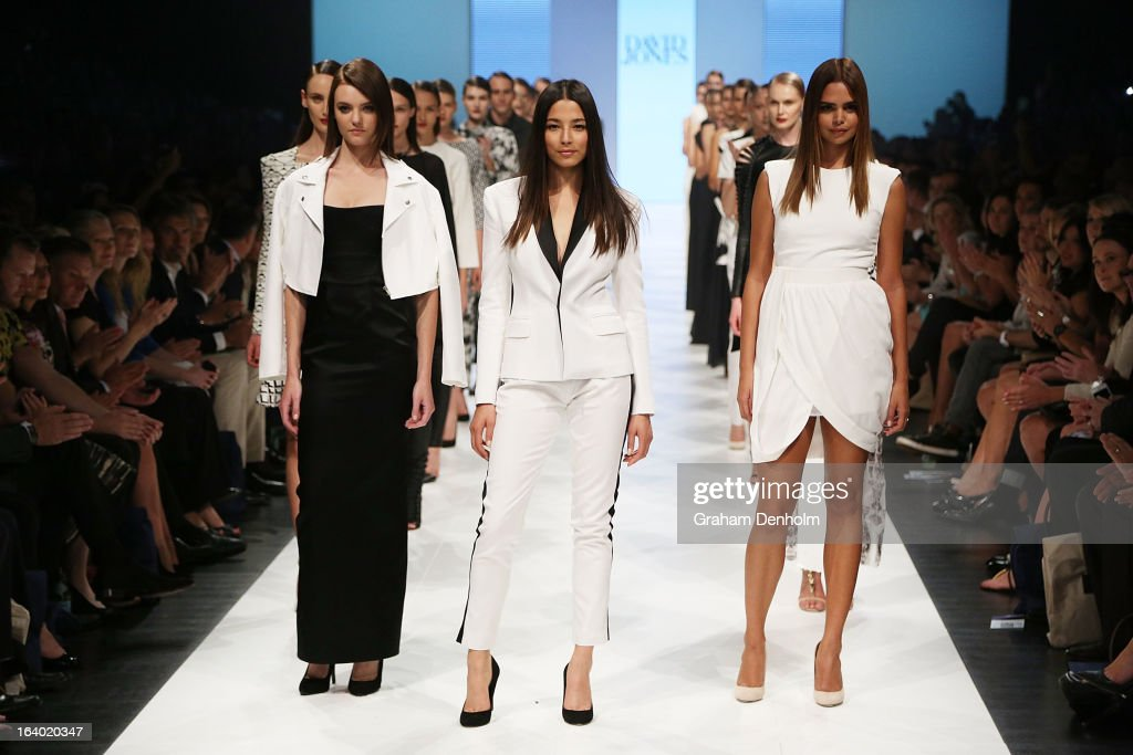 Montana Cox, Jessica Gomes and Samantha Harris pose during the finale of the L'Oreal Melbourne Fashion Festival Opening Event presented by David Jones at Docklands on March 19, 2013 in Melbourne, Australia.