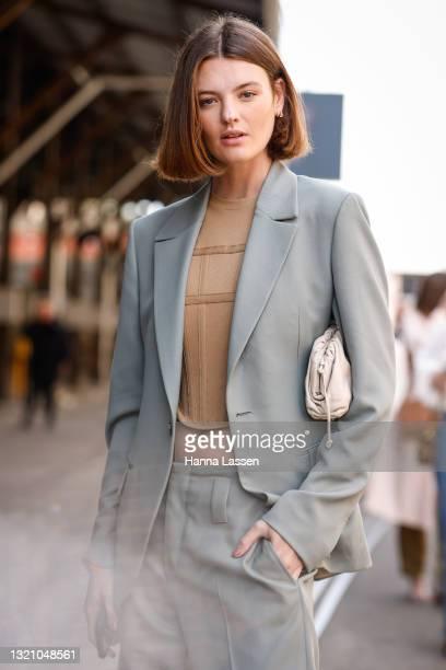 Montana Cox wearing Zegnapastel mint green suit, Dion Lee beige top, Fendi shoes and Bottega Veneta bag at Afterpay Australian Fashion Week 2021 on...