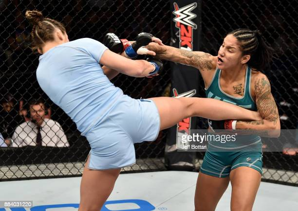 Montana De La Rosa kicks Christina Marks in their women's flyweight bout during the TUF Finale event inside Park Theater on December 01 2017 in Las...