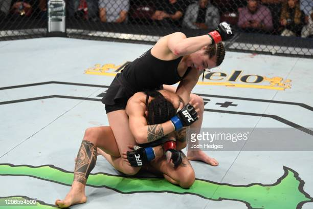 Montana De La Rosa punches Mara Romero Borella of Italy in their women's flyweight bout during the UFC Fight Night event at Santa Ana Star Center on...