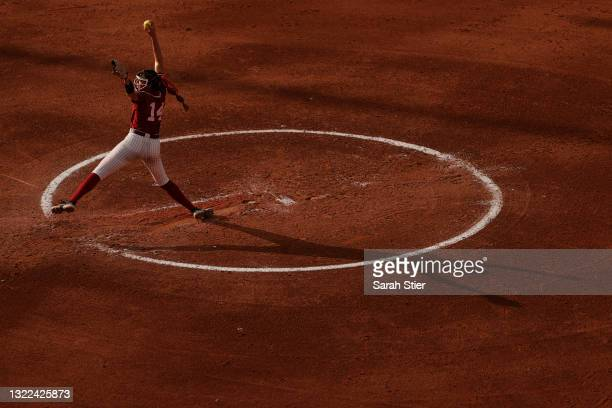 Montana Fouts of the Alabama Crimson Tide pitches during the second inning of Game 14 of the Women's College World Series against Florida St. On June...