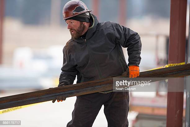 USA, Montana, Kalispell, Man lifting steel bar
