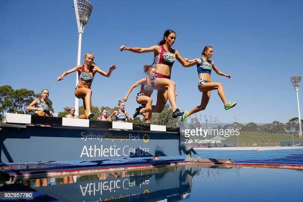 Montana McAvoy leads the race in the Women's 3000 metre Steeplechase Under 20 during day four of the Australian Junior Athletics Championships at the...