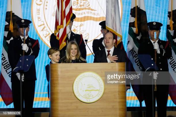 Montana Newsom Hunter Newsom and John Masterson lead the Pledge of Allegiance during the inauguration of Gavin Newsom as governor of California on...