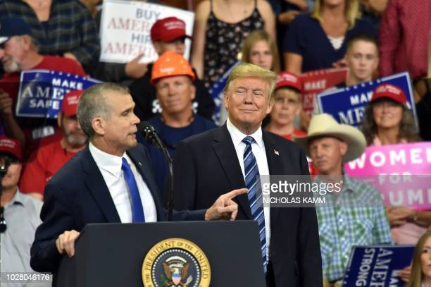 Montana State Auditor and GOP candidate for Senate Matt Rosendale speaks next to US President Donald Trump during a Make America Great Again rally in...