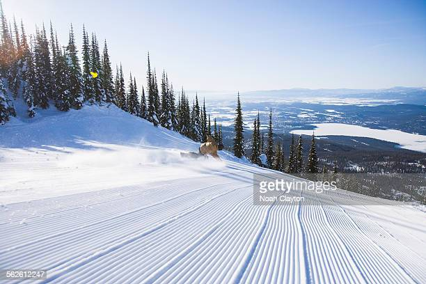 USA, Montana, Whitefish, Snowboarder on side of ski slope