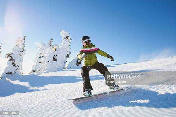 usa, montana, whitefish, snowboarder on slope - snowboarding stock pictures, royalty-free photos & images